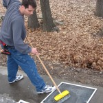 Cleaning screens the wet method